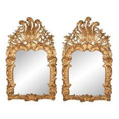 Pair of fine, Spanish Rococo period mirrors: In solid, carved giltwood.  Mid-18th century.Provenance: Chateau de Suisnes, France.