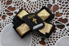 This adorable bow is the perfect bow for any church going princess! The sparkly gold ribbon is sure to make her stand out in the crowd.