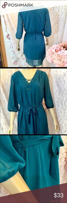 Tie up a lace shirt dress PRODUCT FEATURES Lace-up grommet neckline Sheer 3/4-length sleeves Side-tie sash Lined FIT & SIZING 36-in. approximate length from shoulder to hem A-line design FABRIC & CARE Polyester Machine wash Imported  Hunter green Dresses