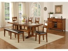 """Winners Only Mango Wood Dining Set;The beauty of mango wood (yes, from the fruit tree) is captured in this traditionally-styled collection of bedroom, dining, entertainment, and occasional furniture. The variation of reflected light off the wood under different angle accentuate the refined,Mango veneer & hardwood construction,One butterfly leaf measures 18"""", Metal corner deco, veneer and solid hardwood construction, distressed finish, straight edges, geared wooden glides, 44W x 74/92D x 30H…"""