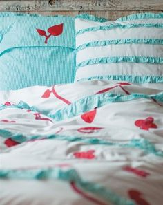 red and aqua bedding