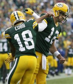 Green Bay Packers' Randall Cobb celebrates his first quarter touchdown with Aaron Rodgers.