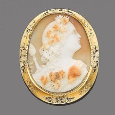 A mid 19th century shell and enamel cameo brooch