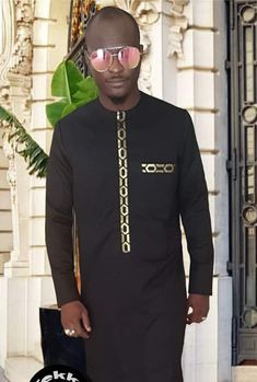Call, SMS or WhatsApp if you want this style, needs a skilled tailor to hire or you want to expand more on your fashion business. African Wear Styles For Men, African Shirts For Men, African Dresses Men, African Attire For Men, African Clothing For Men, Nigerian Men Fashion, African Men Fashion, Mens Fashion, African Print Shirt