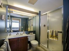 Updated bathrooms with walk-in showers and modern finishes in downtown Detroit apartments. Renaissance City Apartments, luxury apartment living in the Central Business District of downtown Detroit. Urban apartment community with resort-class amenities, convent location and stunning Detroit views.