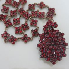 A Victorian bohemian garnet locket necklace.