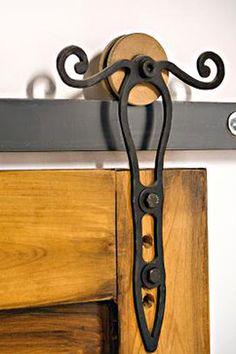 Rod iron doors as closet doors! Barn Door Hardware - Shown with a wooden wheel this Rod Iron barn door hardware can be customized to use any style wheel or color. Exterior Door Hardware, Sliding Barn Door Hardware, Home Hardware, Exterior Doors, Rustic Hardware, Barn Door Designs, Wooden Wheel, Exposed Wood, Iron Doors