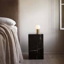 Designed by for the Socket Occasional lamp is cast in brass and designed to fit perfectly on a nightstand, desk, shelf or in a nook. The lamp emits a soft glow, adding luxurious warmth to any space.