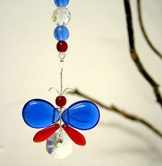 This striking Blue and Red butterfly suncatcher / car charm has been hand crafted from Swarovski crystal & glass beads. Each butterfly has its