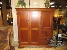 """Handsome Hooker computer cabinet in a medium finish. This is the ideal piece for a home office in need of storage! Just check out the inside, plenty offered! Sells for $2,299 new! What a deal. 55""""W x 25""""D x 62""""H.  Arrived: Tuesday November 15th, 2016"""