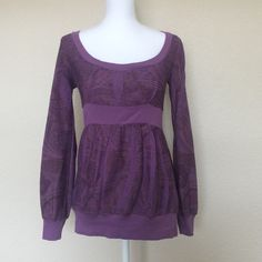 Unique purple top Cute top with unique designs on the back, cute shoulder and waist fit. Like new! Daytrip Tops Tees - Long Sleeve