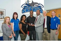 Suffolk County Community College student-athlete, Dannie Holland (center), received an NJCAA 2013 National Championship ring in recognition of his National Title in the Triple Jump. (l to r): Dafny Irizarry, Chairwoman of the College's Board of Trustees; Lauren Biscardi, Assistant Track & Field Coach; Dannie's mother Deon Holland; Dannie Holland; Dr. Shaun L. McKay, President; Kevin Foley, Interim College Director of Athletics, and Matthew French, the College's Head Track & Field Coach