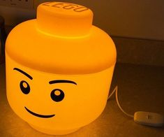 Animate your kid's bedroom with some quaint ambient lighting provided by this LED LEGO head lamp. Made from polypropelene, it is fitted with a 9W LED bulb that emits a warm yellow glow that's as inviting as its joyful smile.