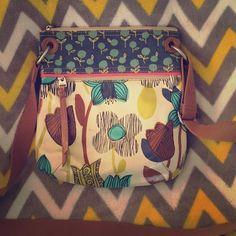 Fossil Floral Key-Per Crossbody Bag Fossil Floral Crossbody Bag. This is a gorgeous bag that is looking for a new home. Very lightly used. There is a little bit of staining on the inside of the front pocket but the main compartment is in perfect condition. Absolutely no tears or stains in the main compartment. There is a slight stain underneath the shellac on the front of the bag that I believe was there when I purchased it. A gorgeous bag waiting for a gorgeous new owner.  Fossil Bags…