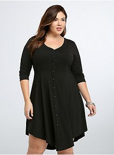 "<p>This is a ""throw it on and go"" kind of dress; it's that easy! Super soft black knit is on the thicker side (perfect for fall), while the v-hem was built to flatter and flare. Easy to dress up or down, you'll find excuses to rock this button down shirt dress.</p>  <p> </p>  <p><b>Model is 5'9"", size 1</b></p>  <ul> 	<li>Size 1 measures 45 1/2"" from shoulder</li> 	<li>Polyester/rayon/spandex</li> 	<li>Hand wash cold, dry flat</li> 	<li>Imported plus size dres..."