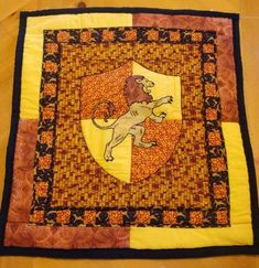 Griffindor quilt -this is a wall quilt, but it would look awesome as a bed quilt too!  Or one with all the house crests! *swoon*