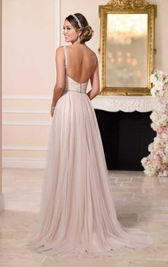 This French Tulle over Matte-side Lavish Satin sheath wedding dress from Stella York features a sexy plunging neckline, low back, and a flowing tulle skirt. See more.
