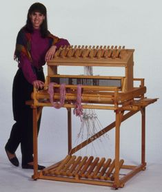 """This is a Mountain Loom Co. """"transportable floor loom"""".  It has a detachable table loom on a stand with treadles."""