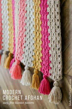 This modern crochet granny stitch blanket free pattern and tutorial is super easy. The tassels make it perfect for a baby nursery or a grown up couch! Made with Lion Brand Heartland yarn (an awesome worsted weight option!) ideas for beginners blanket Crochet Afghans, Motifs Afghans, Afghan Crochet Patterns, Baby Blanket Crochet, Knitting Patterns, Modern Crochet Blanket, Modern Crochet Patterns, Crochet Ideas, Granny Stripe Blanket