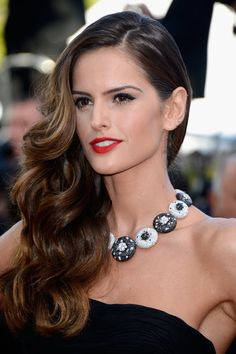 New Pics! The Most Glamorous Hair and Makeup on the Cannes Red Carpet: Model Izabel Goulart went for a retro glamour beauty look at The Immigrant premiere wearing over-the-shoulder waves and red lipstick.