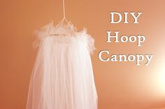 DIY Bed Canopy - could use different colors of tulle.  Use ribbon to tie at top of hoop to hand from ceiling