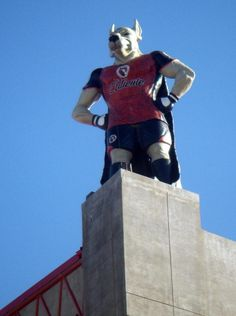 Xolo Mayor, mascot of the Xolos of Tijuana, standing on the roof of Estadio Caliente.