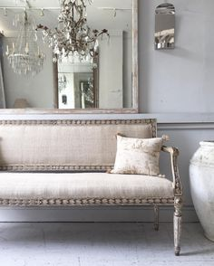 Pretty French/possibly Italian sofa....Crystal chandeliers