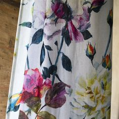 Exquisite roses on a grand scale, with an elegant flowing layout, printed in three refined colourways on soft washed linen.