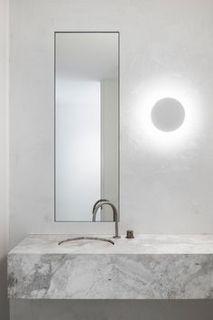 "White plaster walls and concrete floors helped Adam Kane Architects avoid an ""overly feminine"" aesthetic inside the Mariana Hardwick bridal boutique. Minimalist Living, Minimalist Decor, Minimalist Design, Melbourne, White Linen Curtains, Bathtub Remodel, Bath Design, Bathroom Interior Design, Small Bathroom"