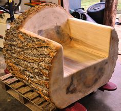 "One of three log chairs that were carved out of a 36"" diameter poplar tree!"