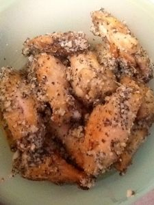 Great recipe - made & family approved 3/12/14.  Here are my adaptations: In place of slow cooking in the oven, I opted for my crock pot - 3-4 hours on high. When browning them in the oven, I cut back the temp to 400 degrees. Since I slow cooked 5# of wings, I followed the recipe for half (added additional 2T of butter) and used honey bbq for the other half.  YUMMY!