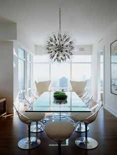 White Lucite chairs, large glass dining table  - New York Apartment by Cara Zolot Interiors