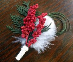 Evergreen and Berry Winter Wedding Boutonniere