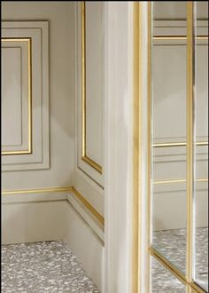 Beautiful wall paneling: gold moulding on off white wall