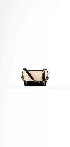 CHANEL's GABRIELLE small hobo bag, aged calfskin, calfskin, ruthenium & gold-tone metal-white & black - CHANEL