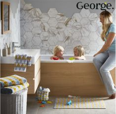 Incorporating scandi style into your bathroom. Geometric prints in yellow and grey paired with natural sandstone accessories give an instant update your bathroom space.