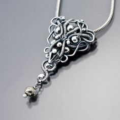 Pendant | Sarah Thompson.  Fine sterling silver, sterling silver beads and a Pyrite bead.