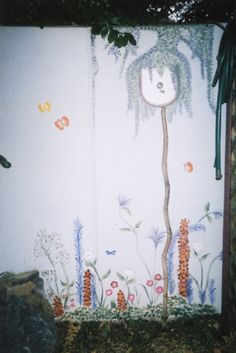 Final section of wall mural - my niece Macina painted the birdhouse after a brief lesson
