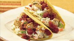 A favorite in California beach towns, fish tacos are a perfect quick meal, here made super-fast with frozen fillets topped with prepared cole slaw and salsa.