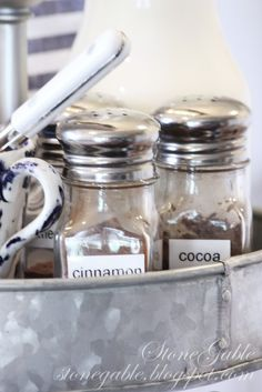 Spices-Cocoa -powdered sugar  in shakers labeled.