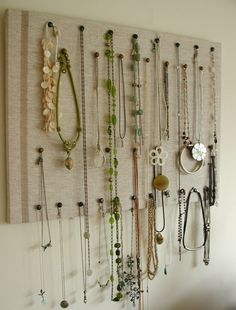 Easy jewelry board.  You could even re-cover an old canvas (from those awful school projects) with some fabric & use that. My mom refuses to get rid of our old art...now it could be something useful!