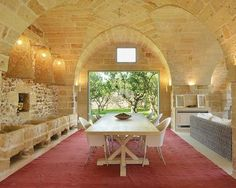 Cushions and cattle troughs combine as luxury boutique hotel opens in 16th century Italian farmhouse