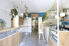 A minimal but elegant materials palette keeps the restaurant looking bright and airy.