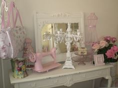 I love shabby chic (who would have ever thought to paint and old sewing machine!)  This site has some cute things