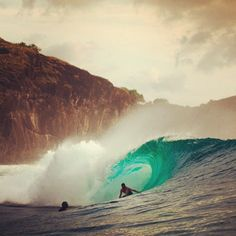 Cool picture of a guy surfing a wave. Like the color of the wave