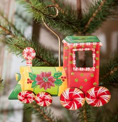 Candy Land Train Ornament - The Round Top Collection The ornament can be…