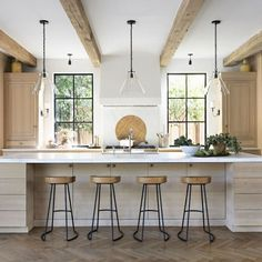Home Wednesday Watch List / Gorgeous indoor/outdoor kitchen with wood beams, wooden island, and natu Kitchen Post, Big Kitchen, Wooden Kitchen, Kitchen Dining, Chef Kitchen, Kitchen Ideas, Kitchen Island Decor, Modern Kitchen Island, Modern Kitchens With Islands