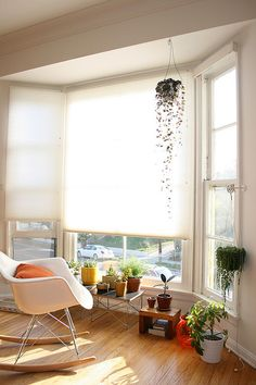 living room | sunny | peaceful | plants | rocking chair
