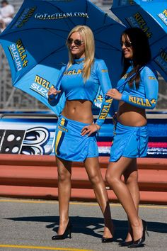 The Suzuki MotoGP umbrella girls sure have a style of their own. Amazing Race Day girls we would say!