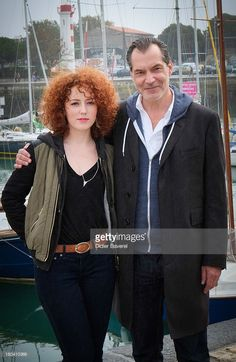 Actress Blandine Bellavoir and actor Samuel Labarthe pose during the photocall of 'Petits Meutres D'Agatha Christie' on September 12, 2013 in La Rochelle, France.